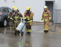 Firefighters removed leaking tank from Actlabs building at 1752 Riverside Drive in Timmins. LEN GILLIS / Postmedia Network