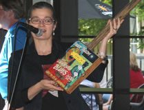 Kincardine Lighthouse Blues Festival's Karen Jacques shows off the one-of-a-kind cigar box guitar available for bidding as a fundraiser for the July 14-16, 2017 event. Sponsors had a chance to see the instrument at the recent Sponsor Appreciation Night. (Troy Patterson/Kincardine News and Lucknow Sentinel)