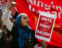 A woman shouts slogans as people march in support of the Muslim community as activists take part in the 'March Against Sharia' at Foley Square on June 10 in New York City. Marches nationwide were organized by the conservative organization ACT for America, which was protesting against elements of Sharia Law that the group believes are increasingly showing up in American society. (Eduardo Munoz Alvarez/Getty Images)