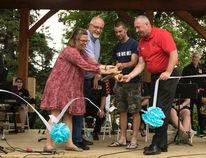 Dignitaries cut a ribbon to officially open the Echo Energy Stage, and launch the 2017 edition of Music in the Park. (Ashli Barrett/Lacombe Globe)