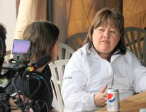 Jennifer Catcheway's mother Bernice, right, speaks with an Australian documentary film crew during Saturday's annual fundraiser at the Catcheway home in Portage la Prairie. (Brian Oliver/The Graphic)