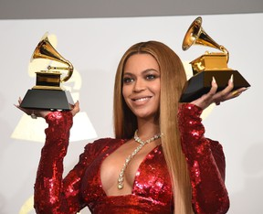 Singer Beyonce poses with her Grammy trophies in the press room during the 59th Annual Grammy music Awards on February 12, 2017, in Los Angeles, California. (ROBYN BECK/AFP/Getty Images)