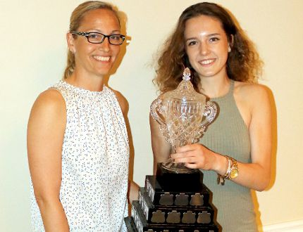 Emma Weltz is presented with her senior girls female athlete of the year trophy by Marcy McCarty during O'Gorman High School's athletic banquet at the Porcupine Dante Club on June 8. It was just one of a number of awards earned by Weltz during the evening. SUBMITTED PHOTO