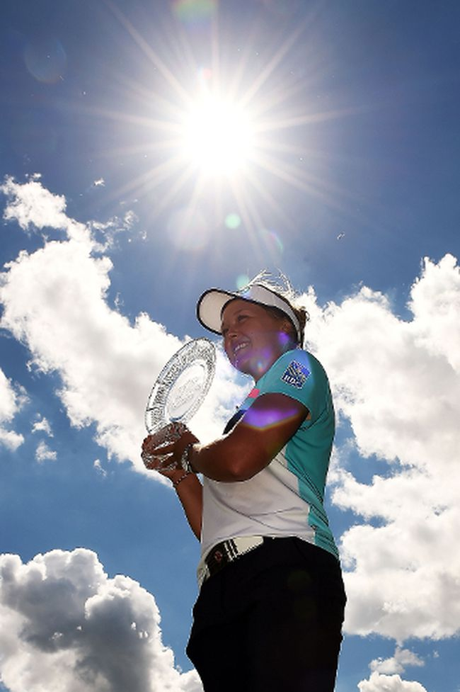 GRAND RAPIDS, MI - JUNE 18:  Brooke Henderson of Canada poses with the championship trophy during the final round of the Meijer LPGA Classic at Blythefield Country Club  on June 18, 2017 in Grand Rapids, Michigan.  (Photo by Stacy Revere/Getty Images)