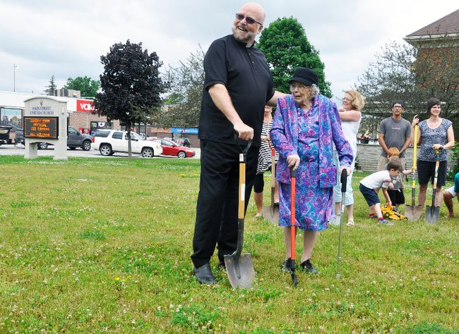 Main Street United Church's Rev. Tom Dunbar and Jean Mitchell, who's 100-years of age, joined together along with the congregation for a ceremonial groundbreaking of their new $1.1 million church building this past Sunday, June 18. The former church was deemed unsafe in 2013 and construction of the new church is expected to begin in early August. Seven months later, God willing, a new church will stand in its place. ANDY BADER/MITCHELL ADVOCATE