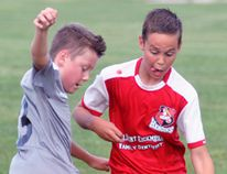 Cy Bergsma (right) of the Mitchell 11U soccer team battles for the loose ball during action against visiting Thorndale on Thursday, June 15. The Herons were full value for a 10-4 win. ANDY BADER/MITCHELL ADVOCATE