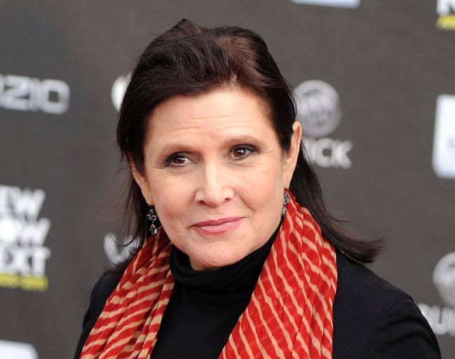 This April 7, 2011 file photo shows Carrie Fisher at the 2011 NewNowNext Awards in Los Angeles. A coroner's report released Monday, June 19, 2017, shows that Fisher had cocaine, ecstasy and heroin in her system when she became ill on a