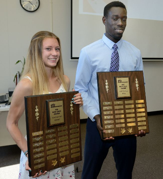 Laura Parkinson of Catholic Central and Ruach Padhal of John Paul II show off the hardware after being named 2017 winners of the Bob Gage Award as top track and field athletes in Thames Valley Regional Athletics on Monday. (MORRIS LAMONT, The London Free Press)