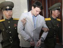 In this March 16, 2016, file photo, American student Otto Warmbier, centre, is escorted at the Supreme Court in Pyongyang, North Korea. Warmbier, an American college student who was released by North Korea in a coma last week after almost a year and a half in captivity, died Monday, June 19, his family said. (AP Photo/Jon Chol Jin, File)