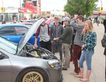 A number of spectators examine the cars displayed at the 28th annual Show N' Shine on Friday, June 24.