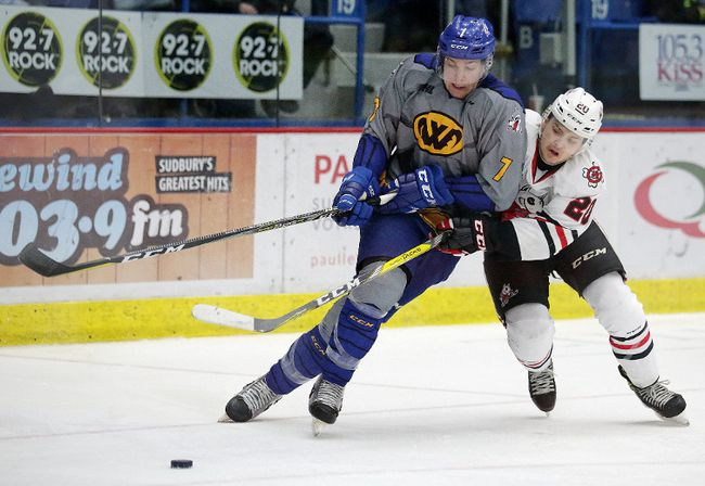 Reagan O'Grady of the Sudbury Wolves battles for the puck with Ondrej Machala of the Niagara Ice Dogs during OHL action from the Sudbury Community Arena on Sunday afternoon. The Wolves held a super hero jeresy game in support of the NEO Kids Foundation. Gino Donato/The Sudbury Star