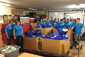 Employees of Sarnia's Express Employment Professionals gathered over a tonne-and-a-half of food for the Inn of the Good Shepherd on June 10 as part of the company's Brand It Blue Day initiative. Handout/Sarnia This Week
