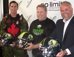 From left: Captain John Hart of the Canadian Armed Forces parachute team, Peter Gabriel of No Limits Youth Organization (NLYO) and Prince Edward Hastings MPP Todd Smith help officially launch the Quinte Skyhawks youth football team Tuesday night in Belleville. (Paul Svoboda/The Intelligencer)