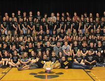 The staff and students of Chesley's high school pose for a final photo after a closing ceremony was held on June 15.