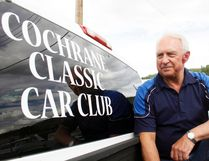 Ray Kaczmer, president of the Cochrane Classic Car Club, poses for a picture Thursday. The club is involving the community with their shows this summer, going to various venues at different businesses in Cochrane.