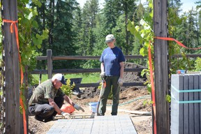 Wilbur (left) and Helen Schutte make sure a patio stone is level for a garden path outside the Forest Interpretive Centre on June 15. Helen Schutte will be judging for Whitecourt Communities in Bloom's annual gardening competition (Peter Shokeir | Whitecourt Star).