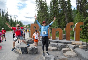 People running in the Banff Marathon ham it up in front of the new Banff entrance sign on Sunday, June 18, 2017. photo by Pam Doyle