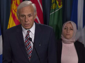 Rania Tfaily, Hassan Diab's wife, looks on as lawyer Donald Bayne responds to a question during a news conference in Ottawa, Wednesday June 21, 2017. ADRIAN WYLD / CP