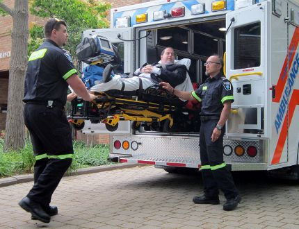 Norfolk paramedics demonstrated a new hydraulic stretcher technology in Simcoe this week prior to Tuesday's meeting of Norfolk council. The paramedics in this photo are Pat Quinn, left, and Bernie Garcia. Serving in the role of patient is Norfolk CAO David Cribbs. The new technology will reduce lifting-related injuries and prolong the careers of aging paramedics. MONTE SONNENBERG / SIMCOE REFORMER