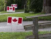Canada flag lawn signs have adorn front lawns on Duchess Ave. in London on Wednesday. (DEREK RUTTAN, The London Free Press)