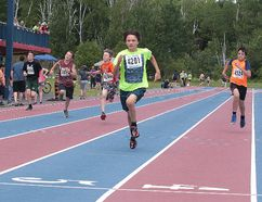Andre Boulet of Northeastern Elementary School leads the pack during the boys 150 metre race at the R.E. Gibson Memorial Champions Meet at the Laurentian University Community Track in Sudbury, Ont. on Wednesday June 21, 2017. Gino Donato/Sudbury Star/Postmedia Network