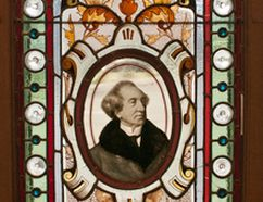 An image of the stained glass window featuring an image of Sir John A. Macdonald, which was donated to the Meaford Museum.