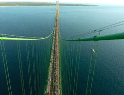 In this Sept. 5, 2005 file photo, thousands of people walk south from St. Ignace across the five-mile Mackinac Bridge during the 48th annual event on the span, which connect the Upper and Lower Peninsulas of Michigan. Michigan officials are questioning the safety of an Enbridge pipeline carrying oil beneath the waterway linking Lake Huron and Lake Michigan. The company says the two segments of the pipeline in the straits recently passed a pressure test. (AP Photo/John L. Russell)