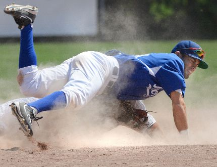 Guelph Royal shortstop Kingsley Alarcon is knocked down at second base after tagging London Major RJ Fuhr out during an Intercounty Baseball League game last August. (Free Press file photo)