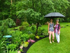 Melinda Wonnacott (left) ramped up her efforts in the garden this spring after learning from Marg O'Reilly (right) and the Stratford and District Horticultural Society's Garden Tour organizing committee that her property would be featured in the tour on July 2. (Galen Simmons/The Beacon Herald)