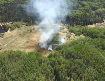 An aerial shot of a wildfire Alberta Forestry officers say was caused by an individual shooting an exploding target south of Fort McMurray, Alta.