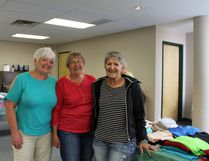 Photo by Jesse Cole Reporter/Examiner Judi Lockhardt (right) joins fellow church members during St. Matthew's Lutheran Church's free 'gift' away event. Lockhardt and the rest of St. Matthews offered up hundreds of articles of donated clothing to the community as a way of saying thank you for all of the donations the church receives each year.