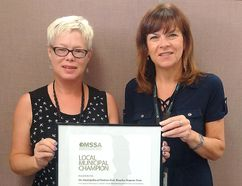 Chantal Perry, left, program manager with Chatham-Kent Employment and Social Services and director Valerie Colasanti, are pictured with Ontario Municipal Social Services Local Municipal Champion award. (Handout/Chatham Daily News)