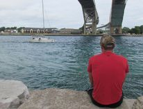A sailboat on the St. Clair River is shown in this file photo approaching the Blue Water Bridge connecting Point Edward with Port Huron. Mich. Sarnia-Lambton MP Marilyn Gladu said legislation passed this week in Ottawa is expected to ease reporting requirements for boaters in border areas. (File photo/Sarnia Observer/Postmedia Network)