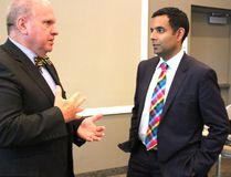 Bluewater Health board chair Wayne Pease, left, talks geriatric care strategy with expert Dr. Samir Sinha during a break at the board's annual general meeting. (NEIL BOWEN/Sarnia Observer)