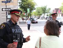 Jason Miller/The Intelligencer Chief Ron Gignac (first from left) and deputy Mike Callaghan speak with citizens during a walkabout in downtown Belleville.