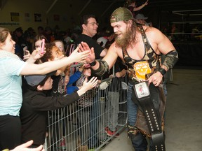 Professional wrestler Cody Deaner greets fans while holding his Canadian heavyweight championship belt. Deaner will headline Vendetta 8, presented by Rock Solid Wrestling at the Caruso Club in Sudbury on July 6. Photo supplied