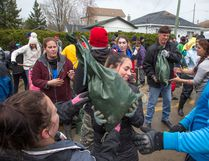 All sorts of volunteers are pitching in with sandbagging at Rue Saint-Louis and Rue Moreau in Gatineau as flooding continues throughout the region in areas along the local rivers. (Wayne Cuddington/Postmedia)