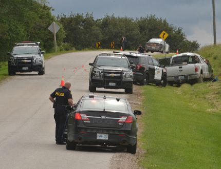 "Perth Line 26 was closed between Road 130 and Road 134 on Friday afternoon and into the evening for an ""ongoing investigation."" Police cruisers surrounded a pickup truck in the ditch near Avonton but wouldn't offer any more details about the incident. (GALEN SIMMONS/The Beacon Herald)"