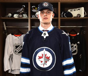Kristian Vesalainen poses for a portrait after being selected 24th overall by the Jets during the 2017 NHL Draft at the United Center in Chicago on Friday, June 23, 2017. (Stacy Revere/Getty Images)