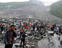 Chinese military police and rescue workers are seen at the site of a landslide in in Xinmo village, Diexi town of Maoxian county, Sichuan province on June 24, 2017. (STR/AFP/Getty Images)