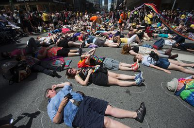 The Dyke March holds a Die In at the corner of College St. and Yonge St. in Toronto, Ont. on Saturday June 24, 2017. The demonstration, lasting about three minutes, was in honour of indigenous, trans, lesbian, and women of colour who have been murdered. Ernest Doroszuk/Toronto Sun/Postmedia Network