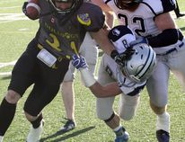 Sudbury Spartans' Erik Conrad (32) and Andrew St. Amour (8) tackle North Bay Bulldogs' Jesse Pledge during Northern Football Conference action at James Jerome Sports Complex in Sudbury on Saturday, June 24, 2017. Ben Leeson/The Sudbury Star/Postmedia Network