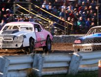 Camaros battle for the front-running position in Merrittville Speedway's 8-cylinder Hoosier Stock class in a qualifying heat Saturday night in Thorold. BERND FRANKE/Postmedia News