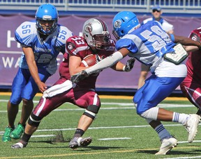Limestone District Grenadier Keegan Wardhaugh comes into contact with Cumberland Panthers Shawn Charles during the first quarter of Ontario Provincial Football League action at Richardson Stadium in Kingston, Ont. on Saturday June 24, 2017. The Grenadiers defeated the Panthers 46-28. Steph Crosier/Kingston Whig-Standard/Postmedia Network