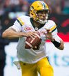 Edmonton Eskimos' quarterback Mike Reilly looks for a receiver during the first half of a CFL football game against the B.C. Lions in Vancouver, B.C., on Saturday, June 24, 2017.