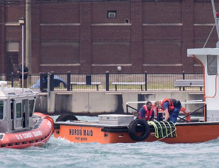 Members of the U.S. Coast Guard give CPR to a male pulled from the Detroit River west of the Ambassador Bridge, June 18, 2017. Dax Melmer / Windsor Star