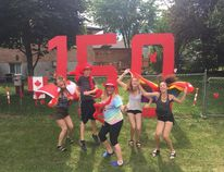 Brian Melady and his spouse Vicki Powers have recently moved to Kingston Ont. The two made a massive Canada 150 sign and invited people from the neighbourhood on their new property to take photos with props for the country's special celebration. (Submitted photo)
