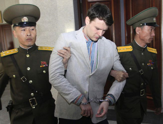 In this March 16, 2016, file photo, American student Otto Warmbier, center, is escorted at the Supreme Court in Pyongyang, North Korea. (AP Photo/Jon Chol Jin, File)