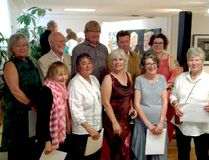 Submitted photo Artist winners gather at the annual Art In The County Juried Exhibition and Sale. Pictured are (back row left to right — jurors award winners) - SaraLou Miller, Graham Davies, Tom Ashbourne, Roderick Samuel, Lesley Snyder. In the front row (left to right) gathered the honourable mention winners Kato Wake, Caroline Shuttle, Andrea Piller, Pauline Dinham and (far right) the 2017 Otto Rogers Award for Excellence, Buffy Carruthers.