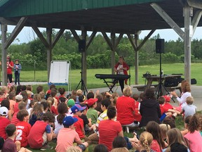 Submitted photo Local singer and songwriter Jeanette Arsenault performed for more than 500 Murray Centennial School students earlier this month. Arsenault will perform her song, This Is My Canada/Mon cher Canada, during Canada Day celebrations in Belleville.
